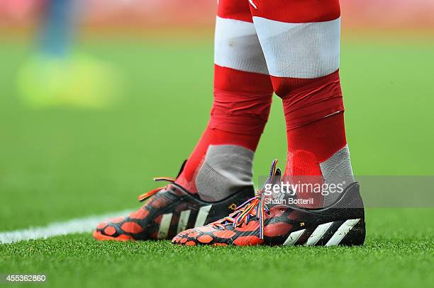 Per Mertesacker of Arsenal wears rainbow laces for antihomophobia campaign during the Barclays Premier League match between Arsenal and Manchester...