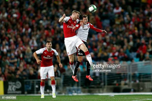 Per Mertesacker of Arsenal wins a header during the match between the Western Sydney Wanderers and Arsenal FC at ANZ Stadium on July 15 2017 in...