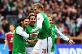Per Mertesacker of Bremen celebrate with his team mates after scoring his team's opening goal during the Bundesliga match between Werder Bremen and 1...