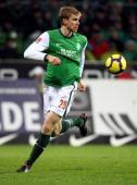 Per Mertesacker of Bremen runs with the ball during the Bundesliga match between Werder Bremen and VfL Wolfsburg at the Weser stadium on November 28...