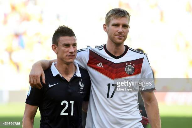 Per Mertesacker of Germany and Laurent Koscielny of France are seen after the 2014 FIFA World Cup Brazil Quarter Final match between France and...