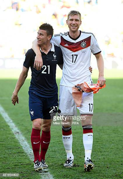 Per Mertesacker of Germany and Laurent Koscielny of France walk off the pitch after the 2014 FIFA World Cup Brazil Quarter Final match between France...