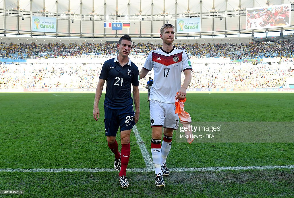 Per Mertesacker of Germany and Laurent Koscielny of France walk off the pitch after the 2014 FIFA World Cup Brazil Quarter Final match between France and Germany at Maracana on July 4, 2014 in Rio de Janeiro, Brazil.