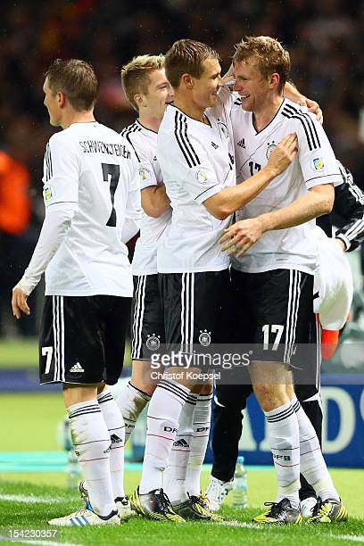 Per Mertesacker of Germany celebrates the third g oalwith Holger Badstuber during the FIFA 2014 World Cup qualifier group C match between German and...