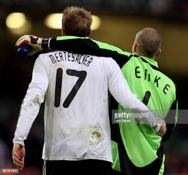 Per Mertesacker of Germany celebrates with goalkeeper Robert Enke after winning the FIFA 2010 World Cup Group 4 Qualifier match between Wales and...