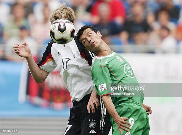 Per Mertesacker of Germany fights for the ball against Jared Borgetti of Mexico during the match between Germany and Mexico for third place in the...