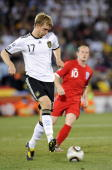 Per Mertesacker of Germany gains control of the ball during the 2010 FIFA World Cup South Africa Round of Sixteen match between Germany and England...