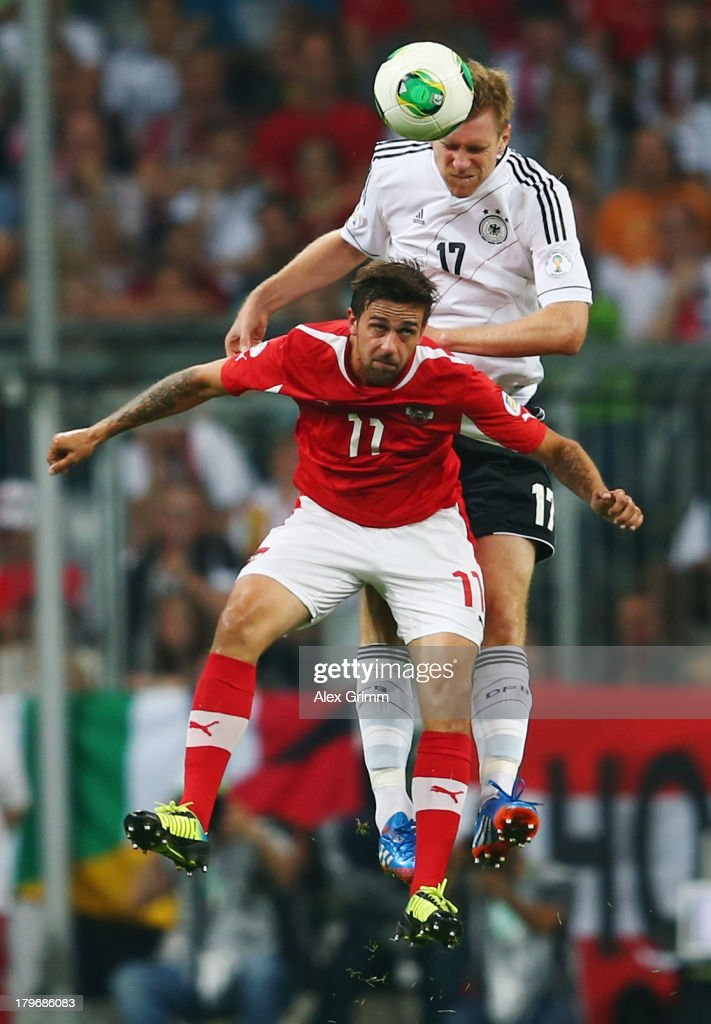 <a gi-track='captionPersonalityLinkClicked' href=/galleries/search?phrase=Per+Mertesacker&family=editorial&specificpeople=207135 ng-click='$event.stopPropagation()'>Per Mertesacker</a> of Germany outjumps <a gi-track='captionPersonalityLinkClicked' href=/galleries/search?phrase=Martin+Harnik&family=editorial&specificpeople=733193 ng-click='$event.stopPropagation()'>Martin Harnik</a> of Austria during the FIFA 2014 World Cup Group C qualifying match between Germany and Austria at Allianz Arena on September 6, 2013 in Munich, Germany.