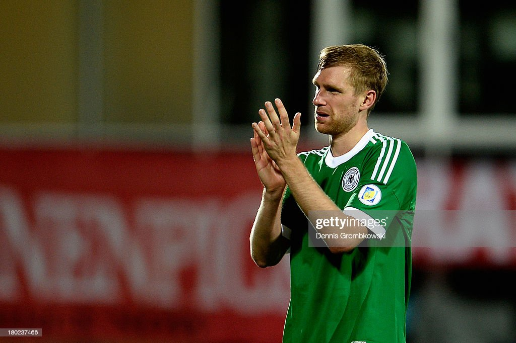 Per Mertesacker of Germany reacts after the FIFA 2014 World Cup Qualifier match between Faeroe Islands and Germany on September 10, 2013 in Torshavn, Denmark.
