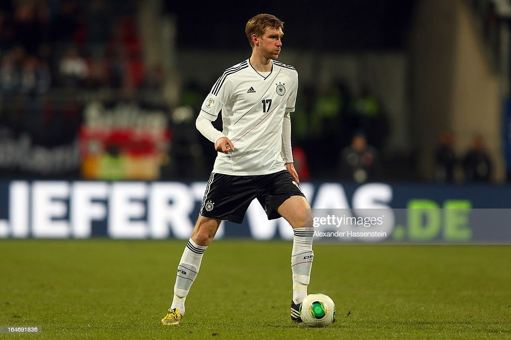 Per Mertesacker of Germany runs with the ball during the FIFA 2014 World Cup qualifier group C match between Germany and Kazakhstan at Gundig-Stadion on March 26, 2013 in Nuremberg, Germany.