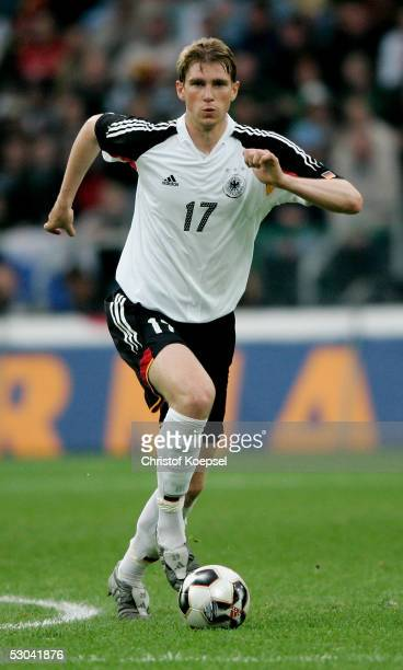 Per Mertesacker of Germany runs with the ball during the friendly match between Germany and Russia on June 8 2005 in Monchengladbach Germany