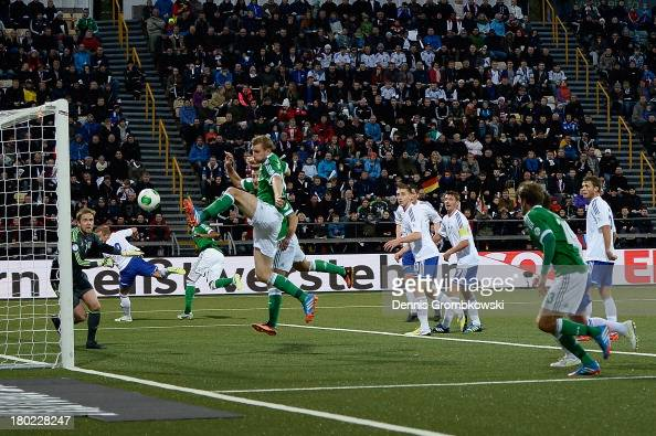 Per Mertesacker of Germany scores his team's first goal during the FIFA 2014 World Cup Qualifier match between Faeroe Islands and Germany on...