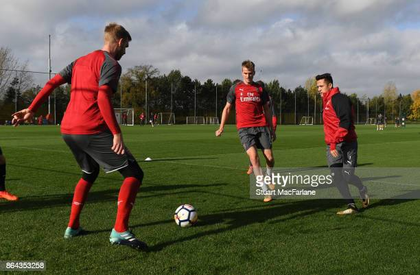Per Mertesacker Rob Hoding and Alexis Sanchez of Arsenal during a training session at London Colney on October 21 2017 in St Albans England