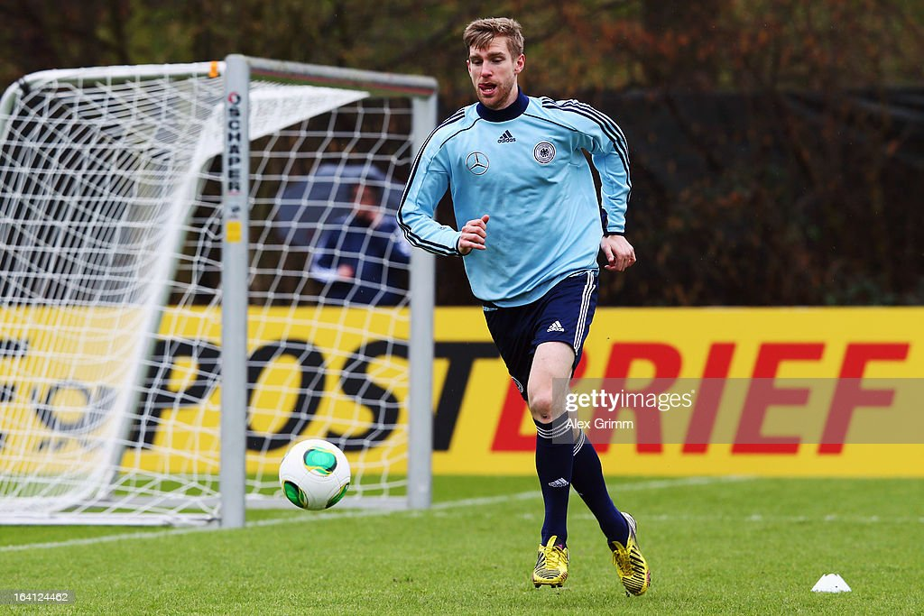Per Mertesacker runs during a Germany training session at 'Kleine Kampfbahn' training ground on March 20, 2013 in Frankfurt am Main, Germany.