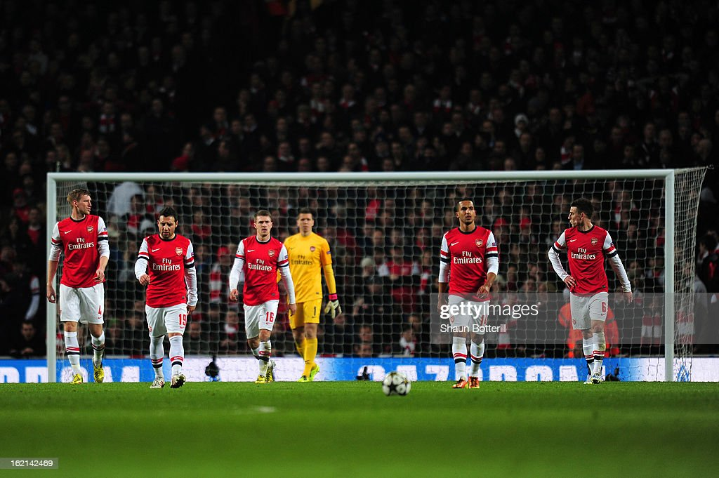 Per Mertesacker, Santi Cazorla, Aaron Ramsey, Wojciech Szczesny, Theo Walcott and Laurent Koscielny of Arsenal show their dejection after conceding a goal during the UEFA Champions League round of 16 first leg match between Arsenal and Bayern Muenchen at Emirates Stadium on February 19, 2013 in London, England.