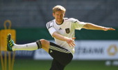 Per Mertesacker stretches during the German National Team training session at esprit Arena on August 31 2011 in Duesseldorf Germany