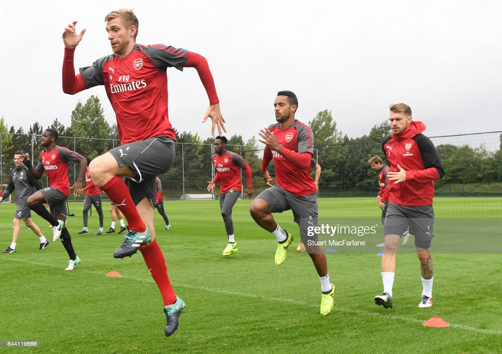 Per Mertesacker, Theo Walcott and Aaron Ramsey of Arsenal during a training session at London Colney on September 8, 2017 in St Albans, England.