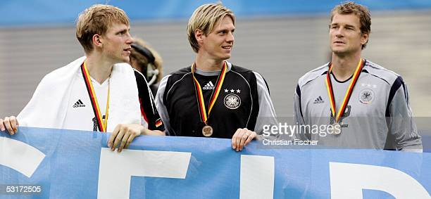 Per Mertesacker Tim Borowski and Jens Lehmann of Germany during the match between Germany and Mexico for third place in the FIFA Confederations Cup...