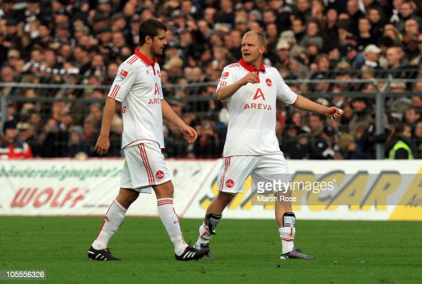 Per Nilsson and Andreas Wolf of Nuernberg look dejected after the Bundesliga match between FC St Pauli and 1 FC Nuernberg at Millerntor Stadium on...