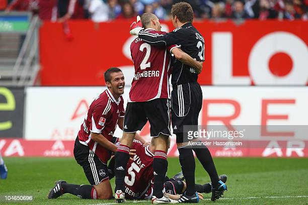 Per Nilsson of Nuernberg celebrates victory with his team mates Andreas Wolf Timmy Simons and keeper Alexander Stephan after the Bundesliga match...