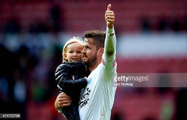 Per Pelle Nilsson of FC Copenhagen celebrates with his child and the fans after the Danish Alka Superliga match between FC Copenhagen and OB Odense...