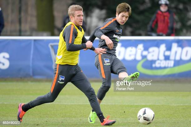 Per Skjelbred and Genki Haraguchi of Hertha BSC during the training on march 15 2017 in Berlin Germany