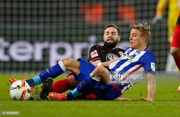 Per Skjelbred of Berlin is tackled by Marc Stendera of Frankfurt during the Bundesliga match between Hertha BSC and Eintracht Frankfurt at...