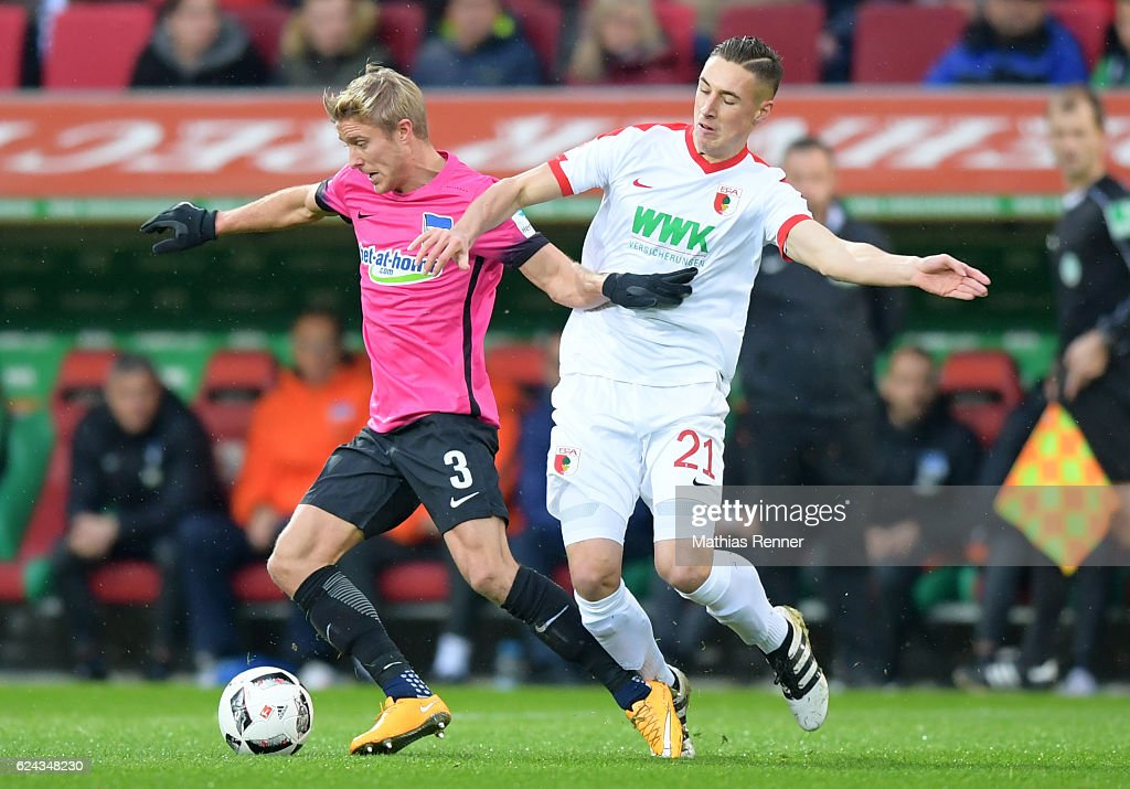 Per Skjelbred of Hertha BSC and Dominik Kohr of FC Augsburg during the game between dem FC Augsburg and Hertha BSC on november 19, 2016 in Augsburg, Germany.