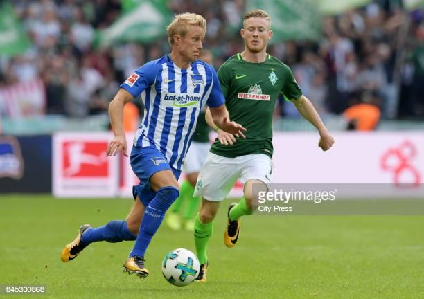 Per Skjelbred of Hertha BSC and Florian Kainz of Werder Bremen during the game between Hertha BSC and Werder Bremen on September 10 2017 in Berlin...