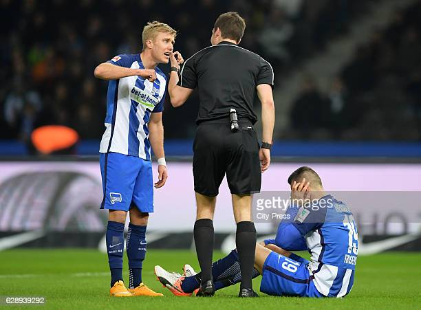 Per Skjelbred of Hertha BSC referee Harm Osmers and Vedad Ibisevic of Hertha BSC during the game between Hertha BSC and Werder Bremen on December 10...