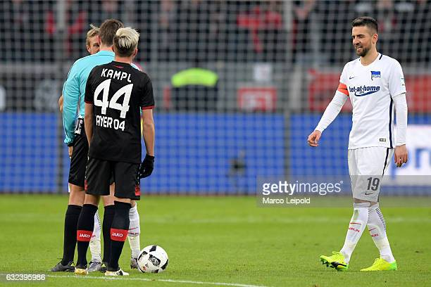 Per Skjelbred referee Tobias Stieler Kevin Kampl of Bayer 04 Leverkusen and Vedad Ibisevic of Hertha BSC during the game between Bayer 04 Leverkusen...