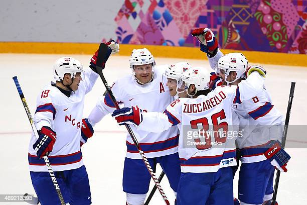 PerAage Skroeder Patrick Thoresen of Norway Mats Zuccarello Aasen of Norway celebrate with teammates after Mathis Olimb of Norway scored a goal...