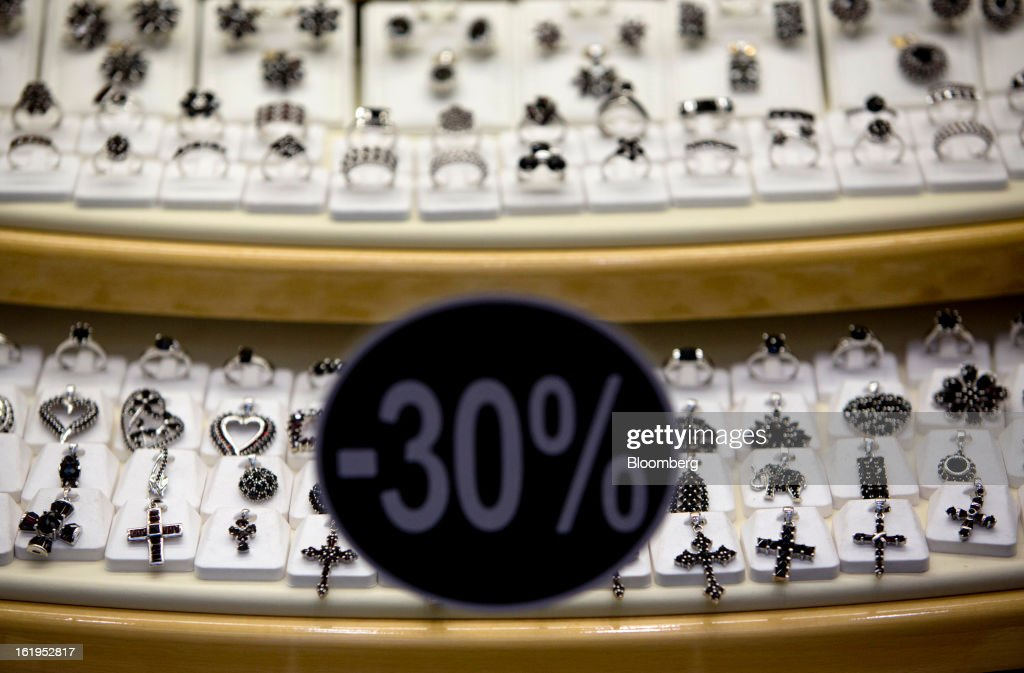 A 30 percent discount sign sits in the window of a jewelry store in central Prague, Czech Republic, on Sunday, Feb. 17, 2013. Worsened outlook for Czech economy is in line with the government's expectations and lower-than-planned tax revenue is 'manageable' under 2013 budget, Prime Minister Petr Necas said on Czech public television. Photographer: Martin Divisek/Bloomberg via Getty Images