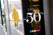 A 50 percent sales discount sign sits in a store window in Paris France on Wednesday Feb 4 2015 The European Commission is 'limited' in the...