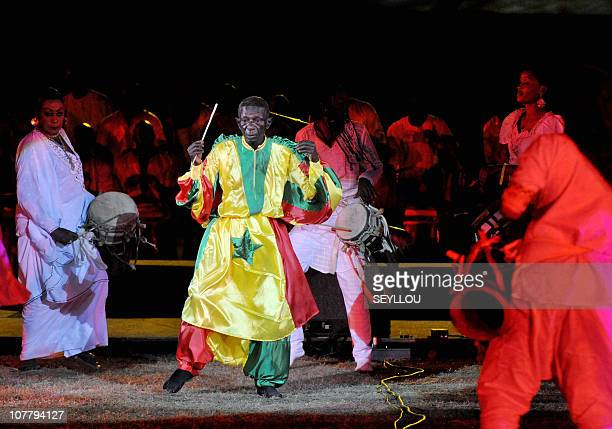 Percussion conductor Doudou Ndiaye Rose performs on December 10 2010 at Leopold Sedar Senghor stadium in Dakar during the opening ceremony of the...