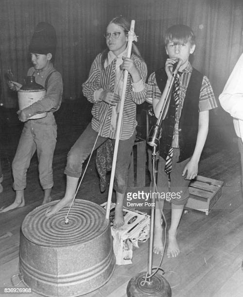 Percussion Section makes with Beat Tommy Duran spoon and jug player left and Tina Lam­bert washtub player carry beat for Oneida Jug Band Credit...