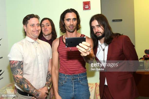 Percussionist Chris Gaylor guitarist Mike Kennerty lead singer Tyson Ritter and guitarist Nick Wheeler of The AllAmerican Rejects visit at Music...