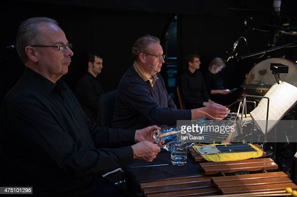 Percussionists prepare in the orchestra pit ahead of a dress rehearsal for Puccini's 'La Boheme' at Royal Albert Hall on February 26 2014 in London...