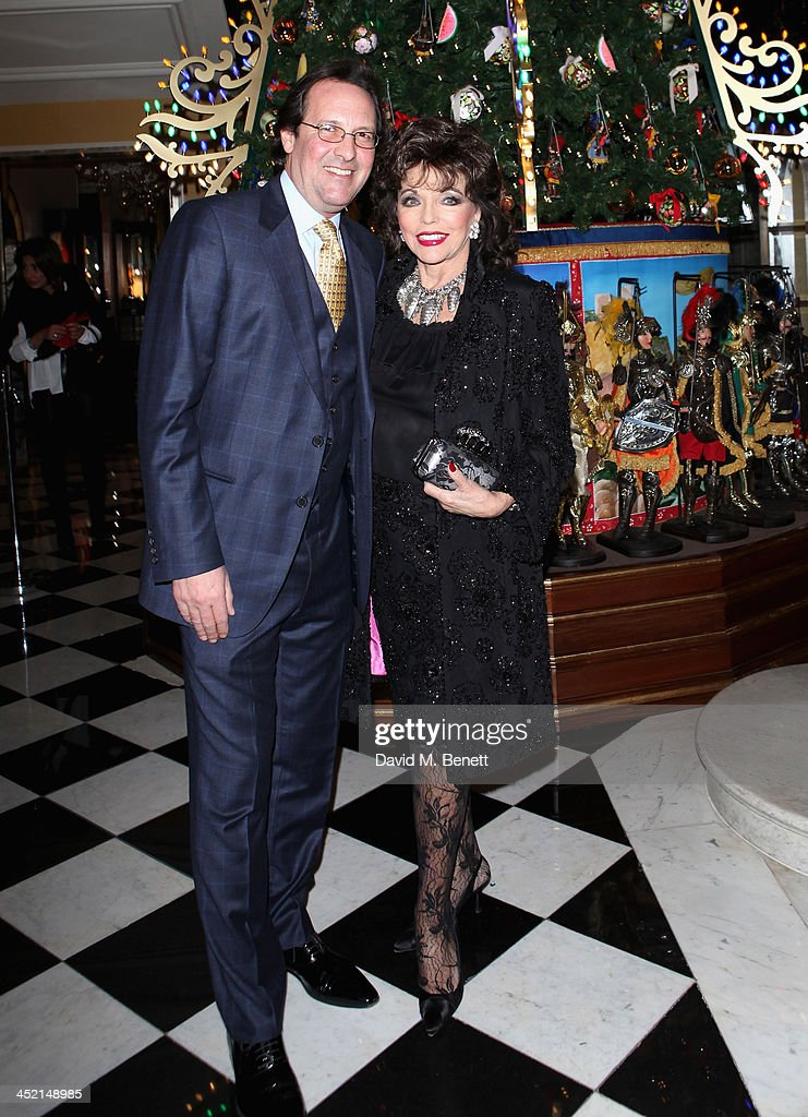 Percy Gibson and Joan Collins attend Claridge's Christmas Tree By Dolce & Gabbana launch party at Claridge's Hotel on November 26, 2013 in London, England.