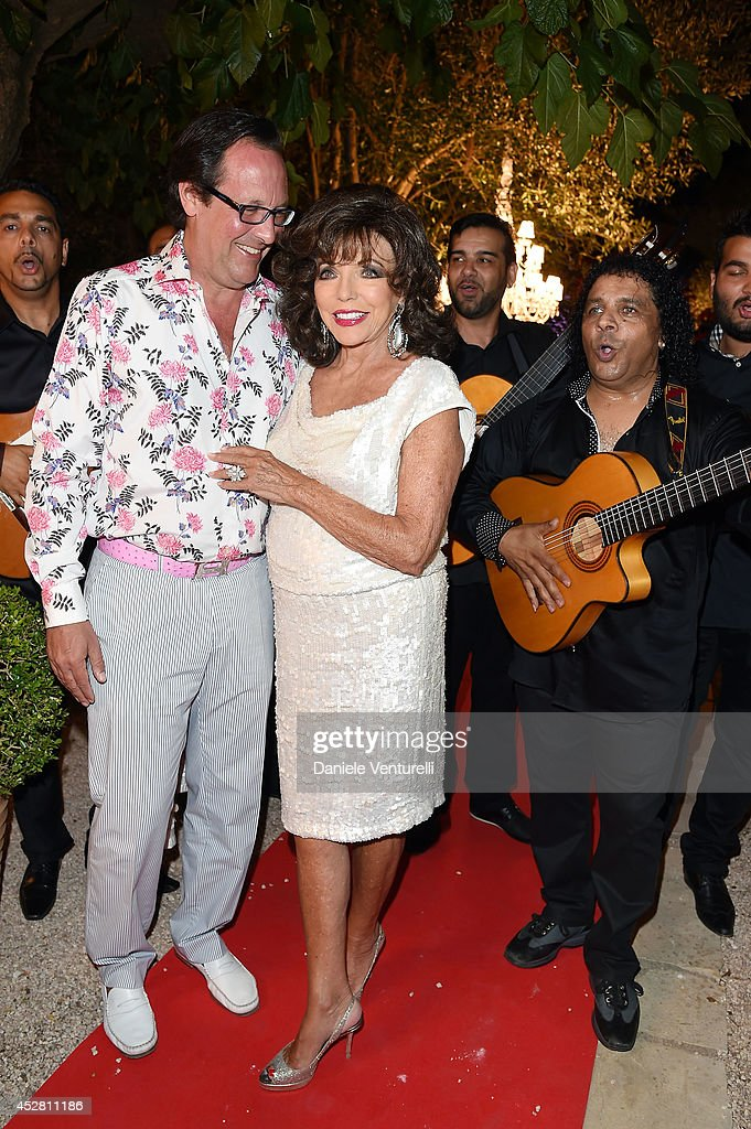 Percy Gibson and Joan Collins attend Monika Bacardi Summer Party 2014 St Tropez at Les Moulins de Ramatuelle on July 27, 2014 in Saint-Tropez, France.