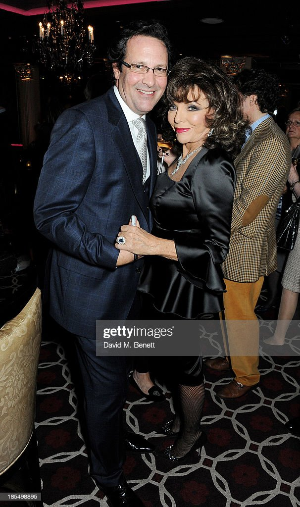 Percy Gibson (L) and Joan Collins attend the launch of Joan Collins new book 'Passion For Life' at No.41 Mayfair Club at The Westbury Hotel on October 21, 2013 in London, England.