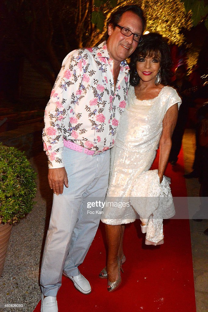 Percy Gibson and Joan Collins attend the Monika Bacardi Summer Party 2014 St Tropez at Les Moulins de Ramatuelle on July 27, 2014 in Saint Tropez, France.