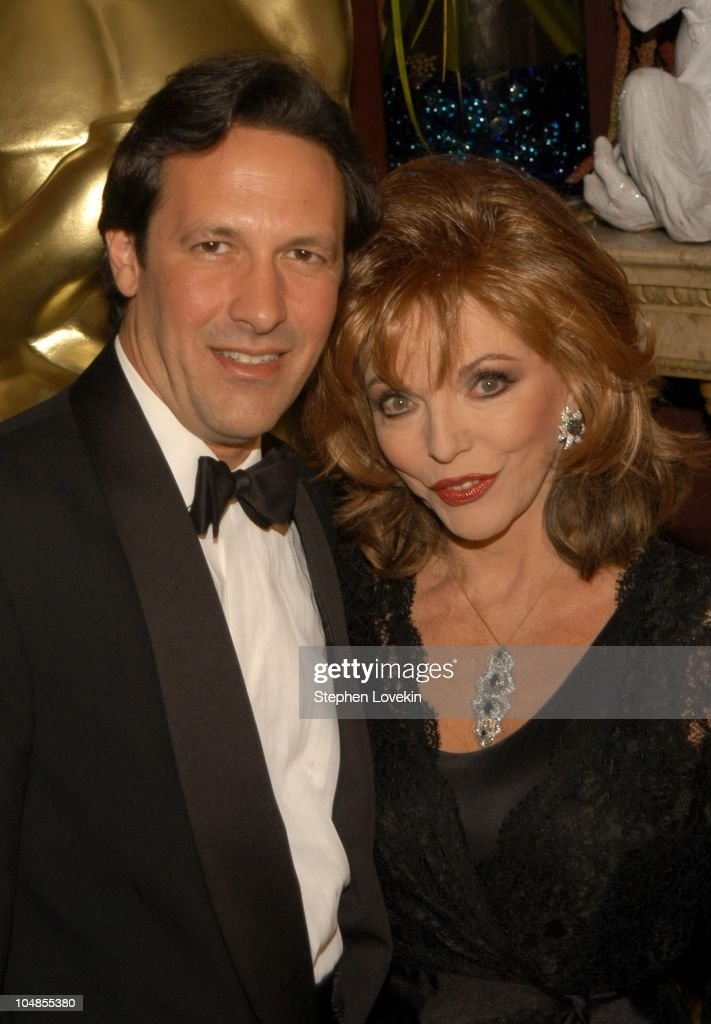 Percy Gibson and Joan Collins during Official 2003 Academy of Motion Picture Arts and Sciences Oscar Night Party at Le Cirque 2000 at Le Cirque 2000 in New York, NY, United States.