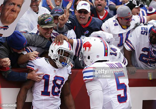 Percy Harvin of the Buffalo Bills celebrates his touchdown with Tyrod Taylor of the Buffalo Bills against the Indianapolis Colts during the first...