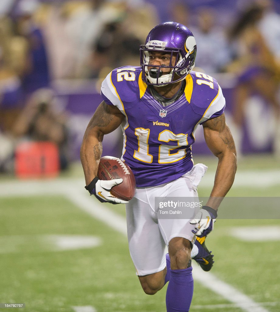 Percy Harvin #12 of the Minnesota Vikings carries the ball during an NFL game against the Tampa Bay Buccaneers at Mall of America Field at the Hubert H. Humphrey Metrodome on October 25, 2012 in Minneapolis, Minnesota.