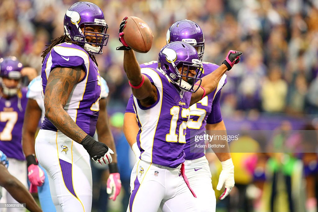 <a gi-track='captionPersonalityLinkClicked' href=/galleries/search?phrase=Percy+Harvin&family=editorial&specificpeople=3061663 ng-click='$event.stopPropagation()'>Percy Harvin</a> #12 of the Minnesota Vikings celebrates a touchdown against the Tennessee Titans at the Hubert H. Humphrey Metrodome on October 7, 2012 in Minneapolis, Minnesota.