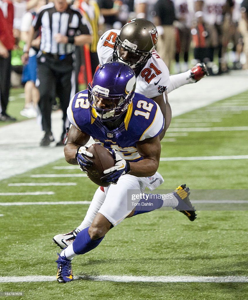 Percy Harvin #12 of the Minnesota Vikings makes a touchdown catch during an NFL game against the Tampa Bay Buccaneers at Mall of America Field at the Hubert H. Humphrey Metrodome on October 25, 2012 in Minneapolis, Minnesota.