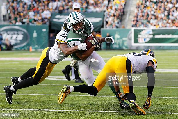 Percy Harvin of the New York Jets in action against Will Allen and William Gay of the Pittsburgh Steelers on November 9 2014 at MetLife Stadium in...