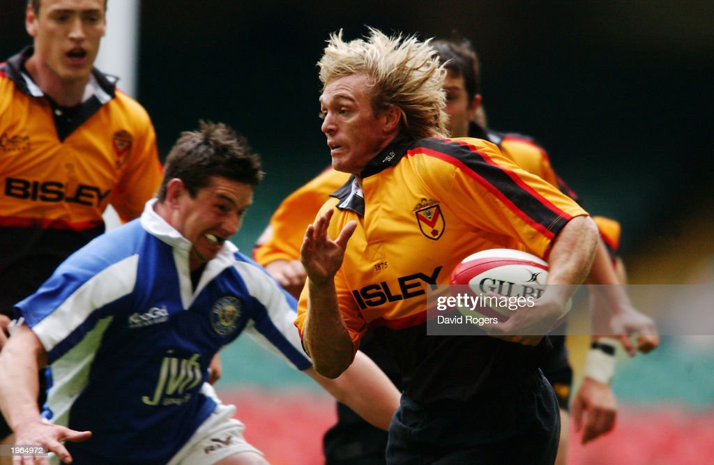 Percy Montgomery of Newport charges forward during the Principality Cup SemiFinal match between Bridgend and Newport held on April 19 2003 at the...