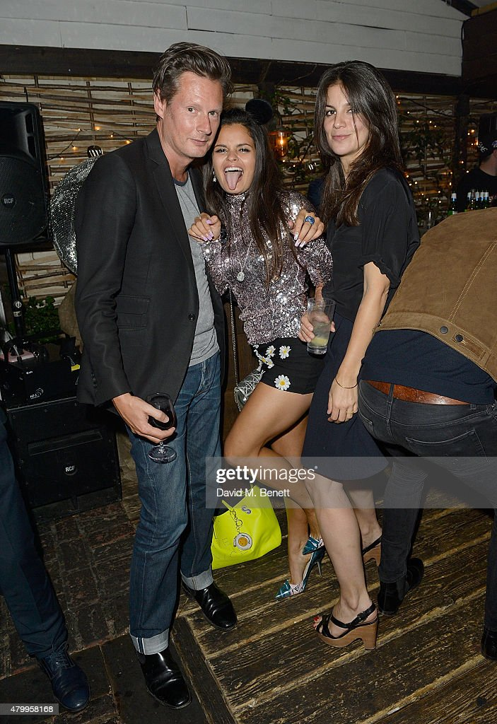Percy Parker and Bip Ling (C) attend the Warner Summer Party in association with British GQ at Shoreditch House on July 8, 2015 in London, England.
